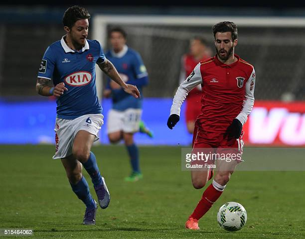 BragaÕs forward Rafa Silva with Os BelenensesÕ midfielder Ruben Pinto in action during the Primeira Liga match between Os Belenenses and SC Braga at...