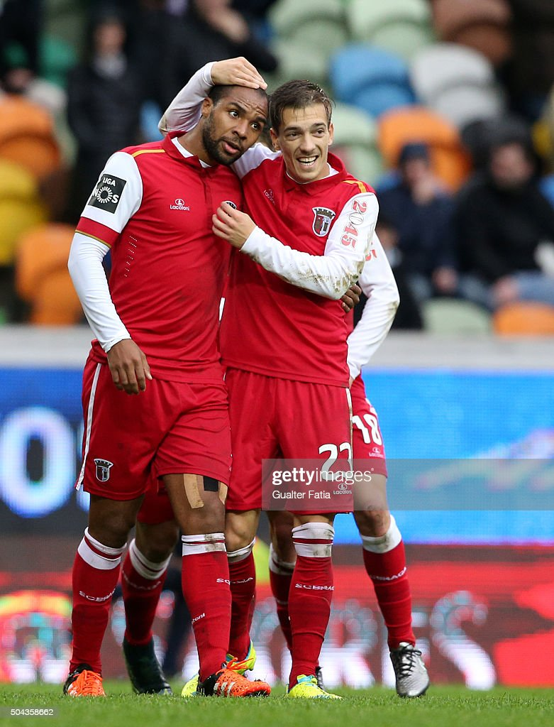 SC Braga's forward <a gi-track='captionPersonalityLinkClicked' href=/galleries/search?phrase=Wilson+Eduardo&family=editorial&specificpeople=7150735 ng-click='$event.stopPropagation()'>Wilson Eduardo</a> celebrates with teammate Pedro Santos after scoring a goal during the Primeira Liga match between Sporting CP and SC Braga at Estadio Jose Alvalade on January 10, 2016 in Lisbon, Portugal.