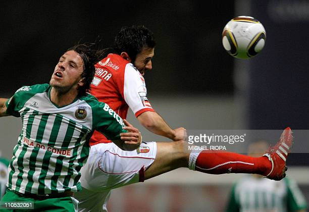 SC Braga´s midfielder Hugo Viana heads the ball next to Rio Ave´s midfielder Vitor Gomes during their portuguese super league football match at the...