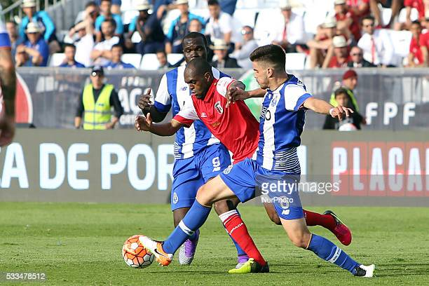 Braga's midfielder Luiz Carlos vies with Porto's midfielder Ruben Neves and Porto's forward Vincent Aboubakar during the Portugal Cup Final football...