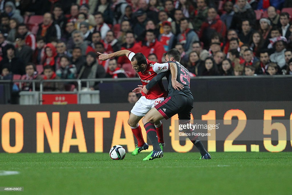 Braga's midfielder Ruben Micael tries to escape Benfica's midfielder Bryan Cristante during the Portuguese Cup match between SL Benfica and SC Braga at Estadio da Luz on December 18, 2014 in Lisbon, Portugal.