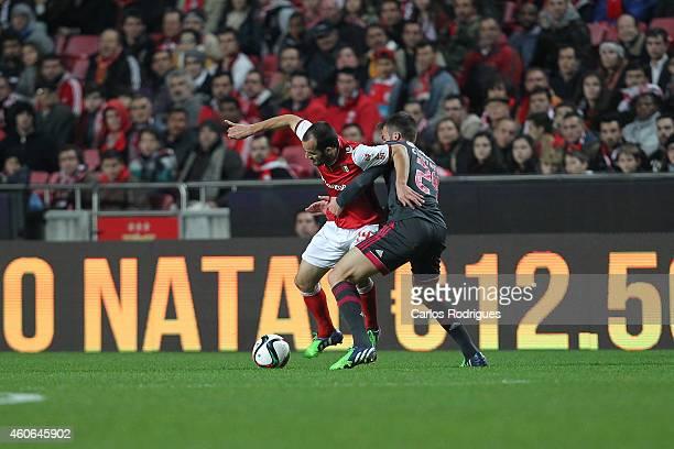 Braga's midfielder Ruben Micael tries to escape Benfica's midfielder Bryan Cristante during the Portuguese Cup match between SL Benfica and SC Braga...