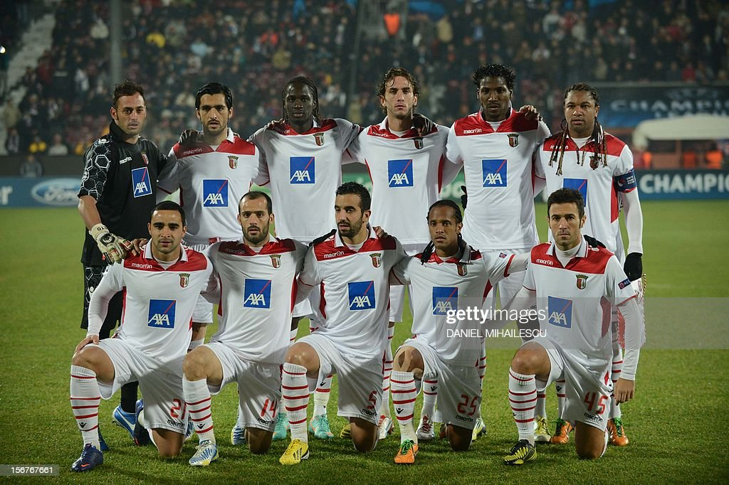Braga's players pose for a team photo prior to the UEFA Champions League Group H match CFR 1907 Cluj vs SC Braga on November 20, 2012 in Cluj Napoca, Romania. Cluj won the match 3-1. (front row, L-R): Braga's Brazilian defender Ismaily Santos, Braga's midfielder Ruben Micael, Braga's midfielder Ruben Amorim, Braga's Brazilian midfielder Leandro Salino and Braga's midfielder Hugo Viana. (row behind, L-R): Braga's goalkeeper Beto, midfielder Custodio, Braga's forward Eder Lopes, Braga's defender Nuno Coelho, Braga's Brazilian defender Douglao Ferreira and Braga's Brazilian midfielder Alan. AFP PHOTO / DANIEL MIHAILESCU