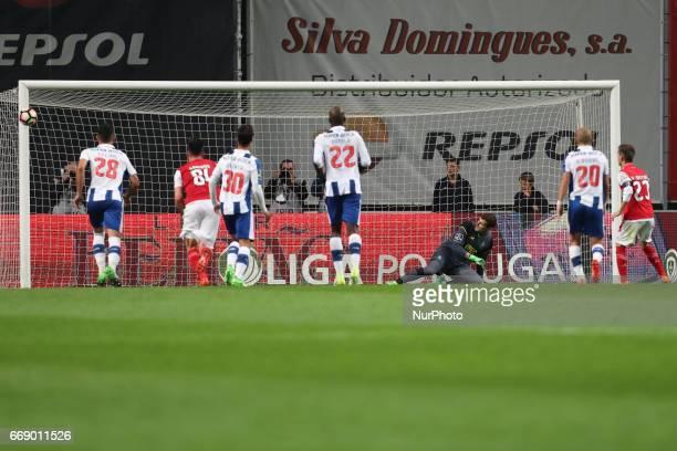 Braga's Portuguese forward Pedro Santos scores on a penalty kick with Porto's Spanish goalkeeper Iker Casillas during the Premier League 2016/17...