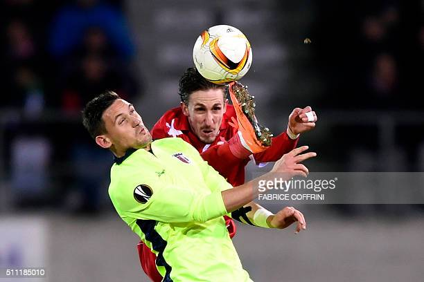 TOPSHOT Braga's Serbian forward Nikola Stoiljkovic vies with Sion's Swiss defender Vincent Ruefli during the UEFA Europa League round of 32 first leg...