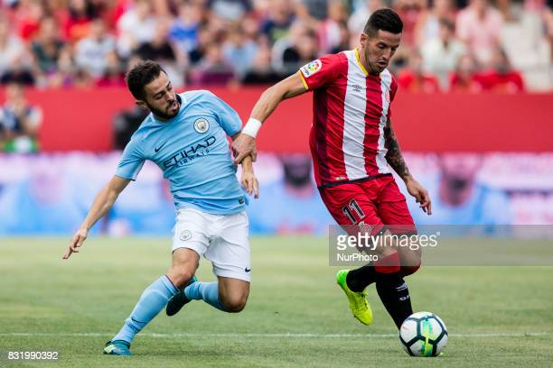 55 Brahim Diaz from Spain of Manchester City defending 11 Aday from Spain of Girona FC during the Costa Brava Trophy match between Girona FC and...