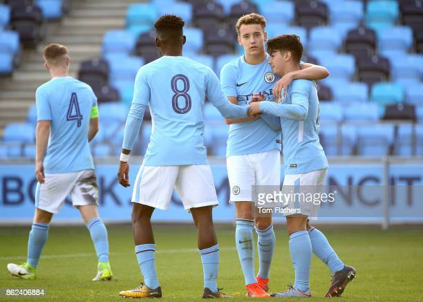 Brahim Diaz of Manchester City celebrates as he scores their second goal from a penalty with team mates during the UEFA Youth League Group F match...