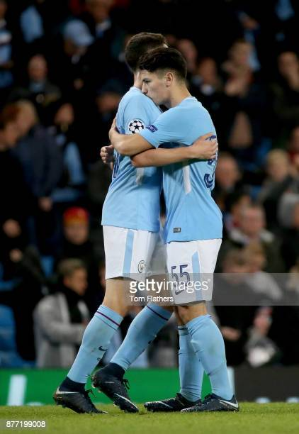 Brahim Diaz of Manchester City celebrates with Phil Foden after the UEFA Champions League group F match between Manchester City and Feyenoord at...