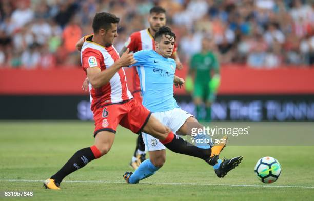 Brahim Diaz of Manchester City competes with Alex Granell of Girona during the preseason friendly match between Girona and Manchester City at...