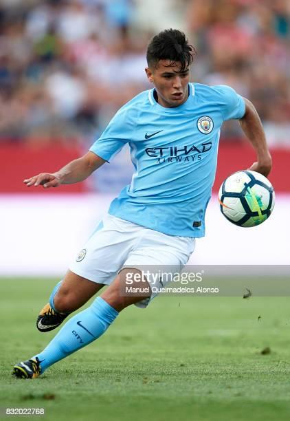 Brahim Diaz of Manchester City runs with the ball during the preseason friendly match between Girona and Manchester City at Municipal de Montilivi...