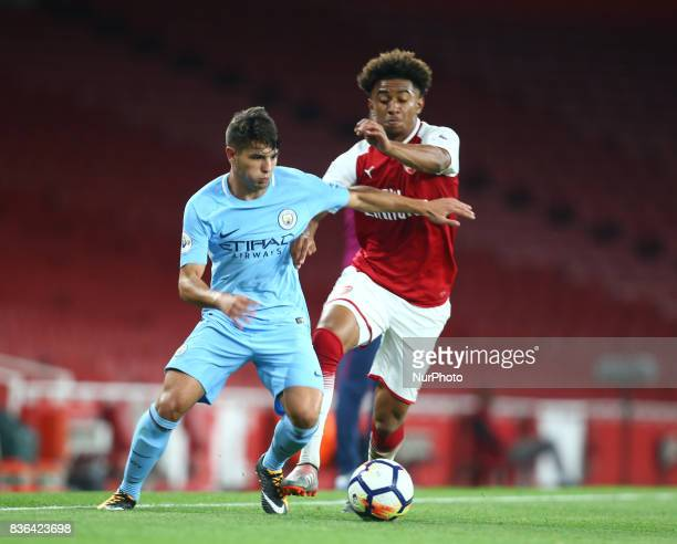 Brahim Diaz of Manchester City Under 23s holds of Reiss Nelson of Arsenal U23s during Premier League 2 match between Arsenal Under 23s against...