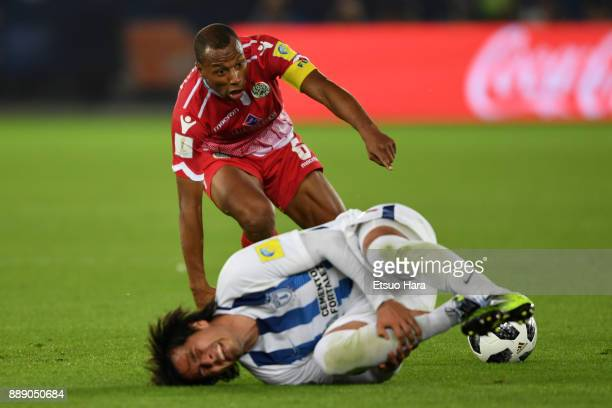 Brahim Nakach of Wydad Casablanca tackels Jorge Hernandez during the FIFA Club World Cup match between CF Pachuca and Wydad Casablanca at Zayed...