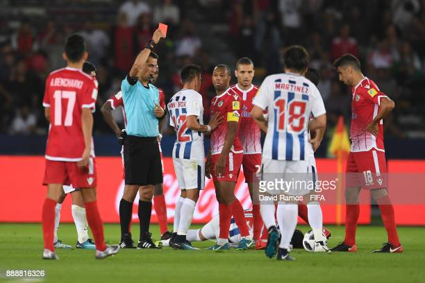 Brahim Nekkach of Wydad Casablanca is shown a red card by referee Ravshan Irmatov during the FIFA Club World Cup match between CF Pachuca and Wydad...