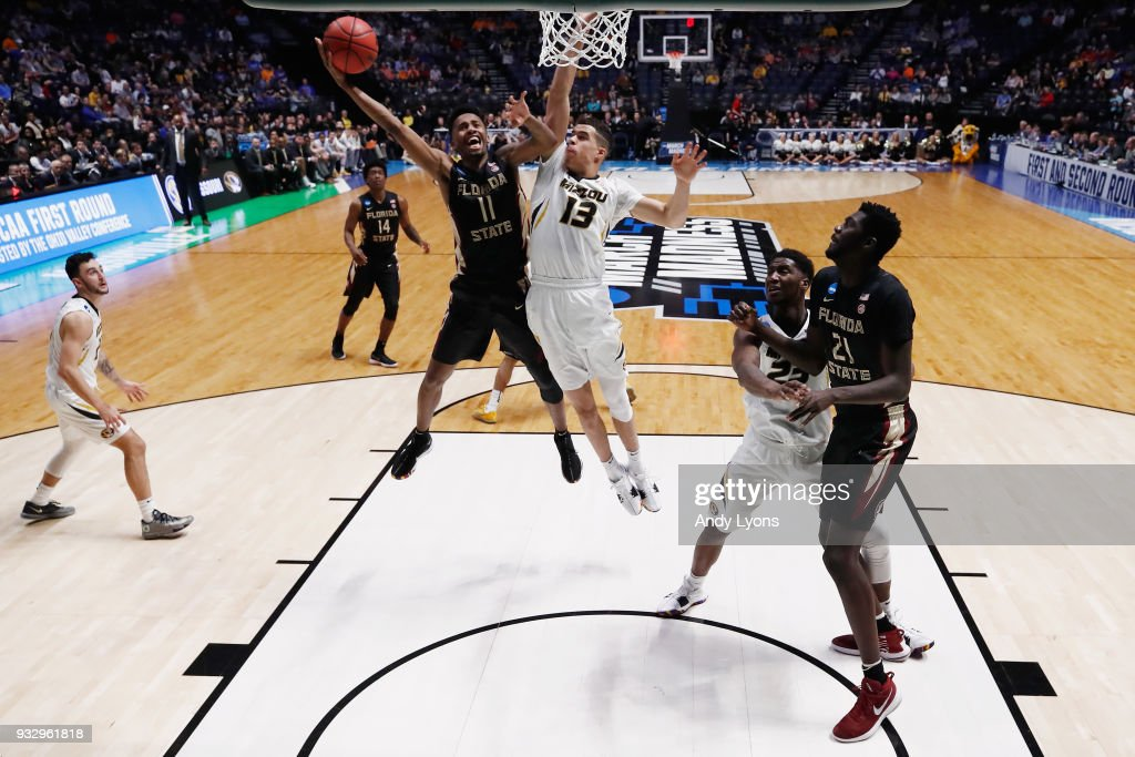 Braian Angola #11 of the Florida State Seminoles shoots a layup over Michael Porter Jr. #13 of the Missouri Tigers during the game in the first round of the 2018 NCAA Men's Basketball Tournament at Bridgestone Arena on March 16, 2018 in Nashville, Tennessee.