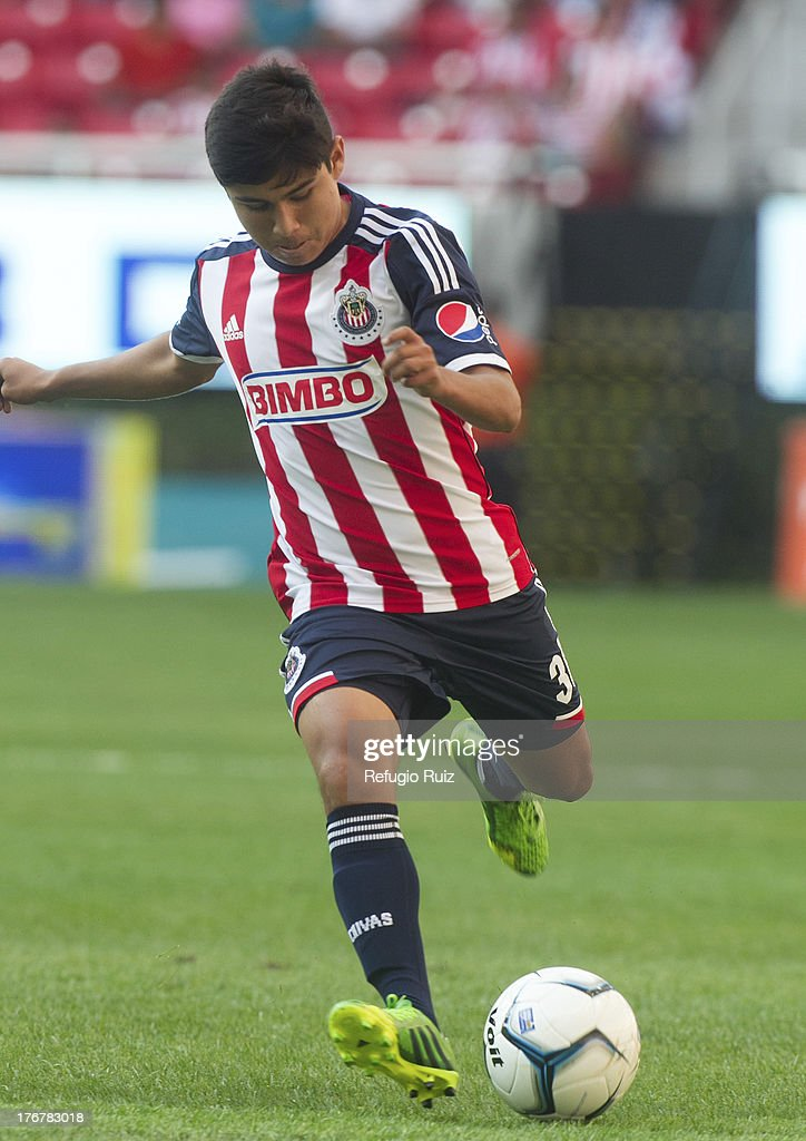 Braian Leyva of Chivas drives the ball during a match between Chivas and Puebla as part of the Torneo Apertura Liga MX at the Omnilife Stadium on August 18, 2013 in Guadalajara, Mexico.