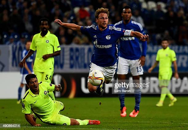 Braian Lluy of Asteras challenges Benedikt Hoewedes of Schalke during the UEFA Europa League Group K match between FC Schalke 04 and Asteras Tripolis...