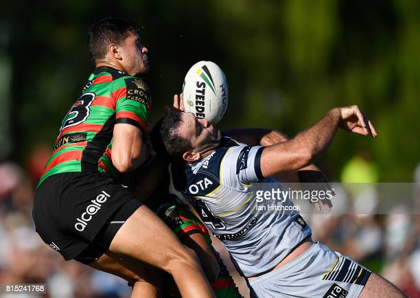 Braidon Burns of the Rabbitohs contests the high ball with Kane Linnett of the Cowboys during the round 19 NRL match between the South Sydney...