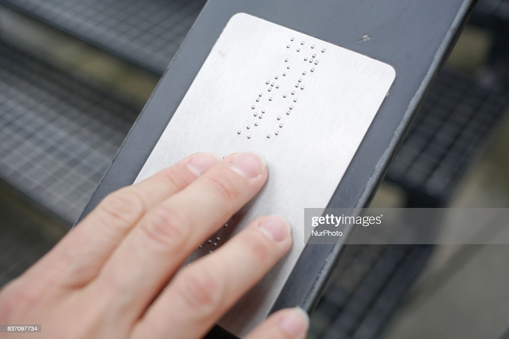A braille plate is seen on the railing of a bridge in the old center of the city of Bydgoszcz, Poland on 20 August, 2017.