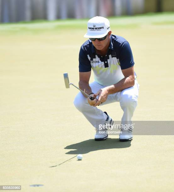 Brain Gay looks over his putt on the 15th hole during the third round of the Wyndham Championship on August 19 2017 at Sedgefield Country Club in...