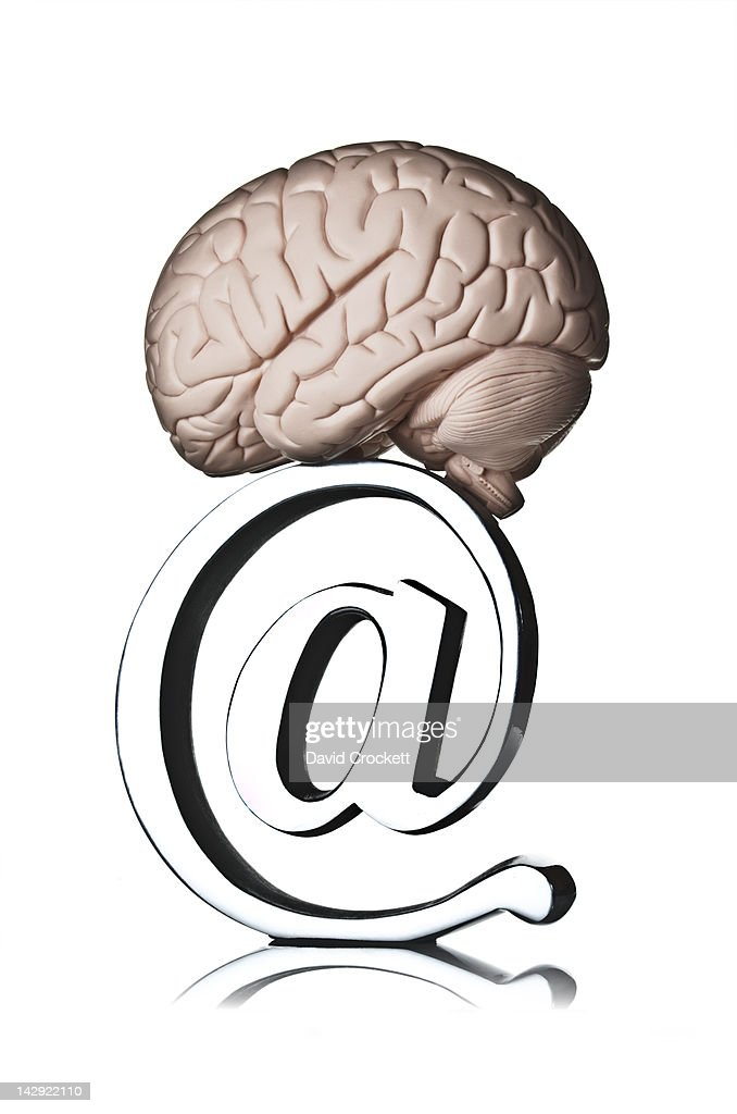 Brain on top of 'at' symbol : Stock Photo