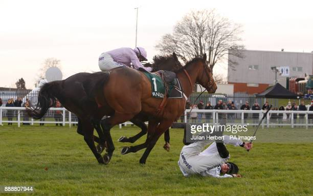 Brain Power and David Mullins part company at the last fence befoire during The Randoxhealthcom Henry VIII Novices' Steeple Chase Race run during day...