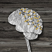 Brain rehabilitation and mental health therapy concept as a crumpled broken paper shaped as the human thinking organ repaired together with tape as a neurology medical treatment symbol.