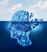 Brain trauma and aging or neurological damage concept as an iceberg floating in an ocean breaking apart as a health crisis metaphor for human mental stress and a symbol for psychology and psychiatric