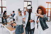 Brainstorming. Virtual Reality Glasses. Look. Designers. Young Specialists. Choose Colors for Design. Teamwork. Discussion. Design Studio. Multi-Ethnic. Project. Creative. Workplace.