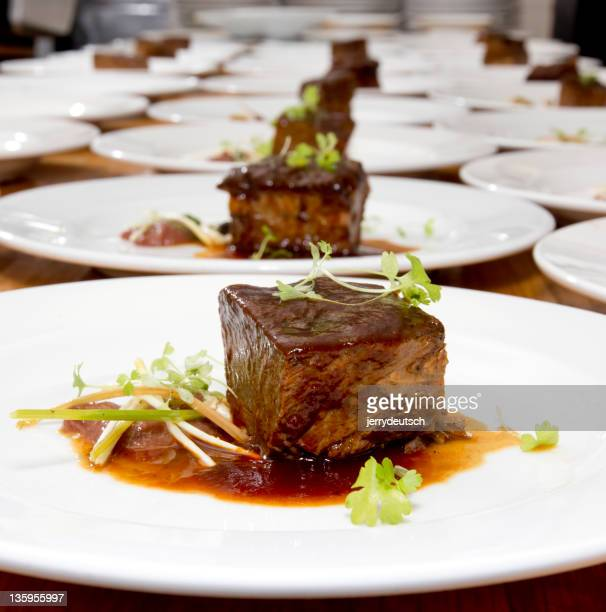 Braised Beef Ribs on White Plates, Ready to be Served