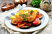 Braised chicken in white wine with eggplant, tomato and french fries.