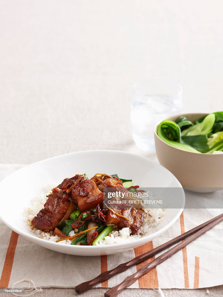 Braised meat with vegetables and rice : Stock Photo