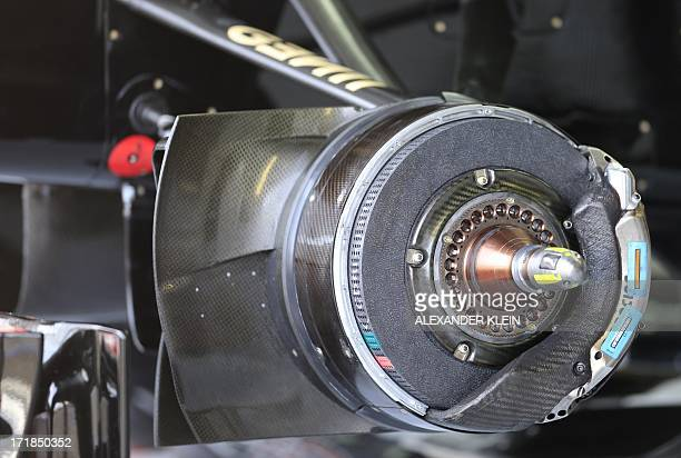 Brake pads and calipers are pictured in the pits during the third practice session at the Silverstone circuit in Silverstone on June 29 2013 ahead of...