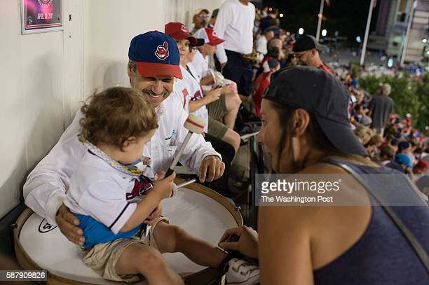 Bram Chelf 22 months old sits on John Adams' drum with her aunt Mollie Merritt as the Nationals face off agains the Indians at Progressive Field in...