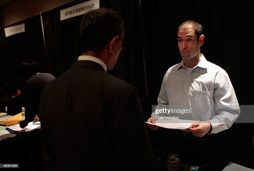 Bram Daly (R), a job recruiter for the Charles Schwab company, speaks to one of a long line of job hopefuls during the 'Keep America Working' job fair at the Marriot Marquis Hotel in Times Square on March 5, 2009 in New York City. Thousands of job applicants showed up for the fair sponsored by the job placement service Monster.com which will tour nationally around the country. New York City has lost tens of thousands of jobs, a great percentage in the finance sector, due to the economic crisis.