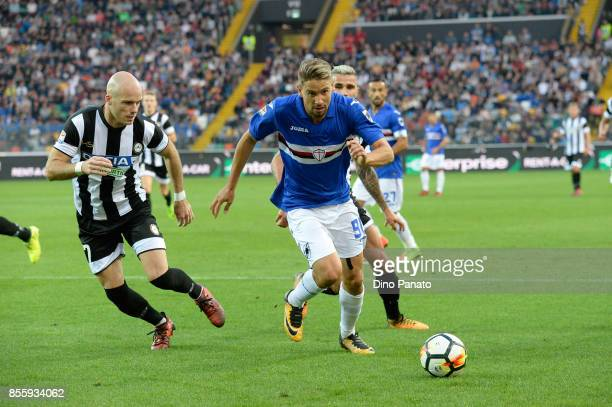 Bram Nuytinc of Udinese Calcio competes with Gaston Ramirez of UC Sampdoria during the Serie A match between Udinese Calcio and UC Sampdoria at...