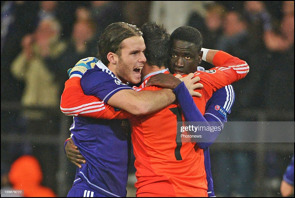 Bram Nuytinck (L) and goalkeeper Silvio Proto of RSC Anderlecht cdelebrate during the UEFA Champions League Group C match between RSC Anderlecht and FC Zenit St Petersburg at the Constant Vanden Stock Stadium on November 6, 2012 in Brussels, Belgium.
