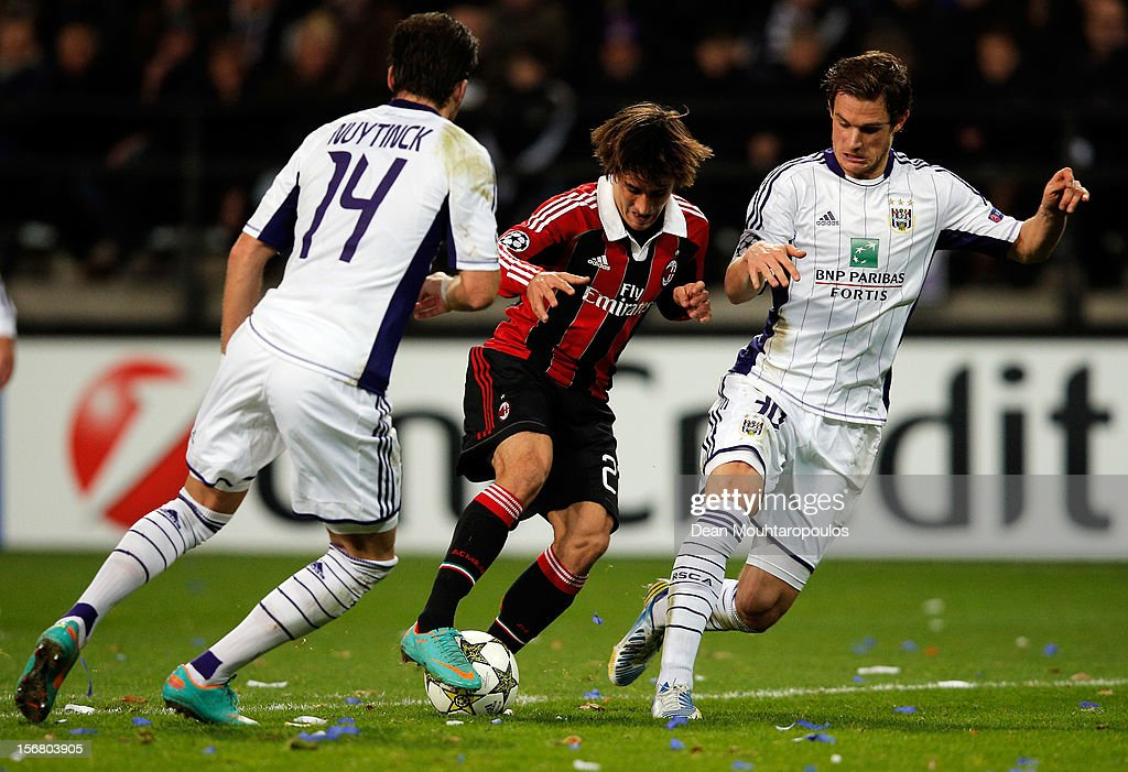 Bram Nuytinck (#14) and Guillaume Gillet (R) of Anderlecht stop Bojan Krkic of AC Milan during the UEFA Champions League Group C match between RSC Anderlecht and AC Milan at the Constant Vanden Stock Stadium on November 21, 2012 in Anderlecht, Belgium.