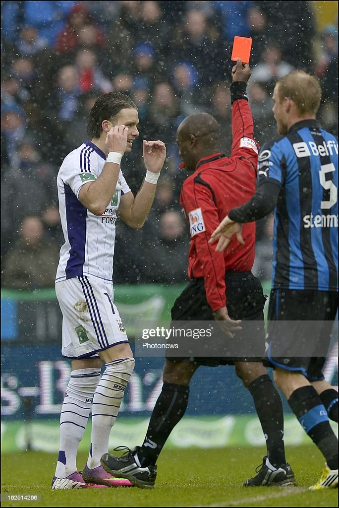Bram Nuytinck of RSC Anderlecht is shown a red card by referee Jerome Nzolo during the Jupiler League match between Club Brugge and RSC Anderlecht on February 24, 2013 in the Jan Breydel Stadium in Brugge, Belgium.