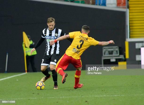 Bram Nuytinck of Udinese Calcio competes with Gaetano Letizia of Benevento Calcio during the Serie A match between Udinese Calcio and Benevento...