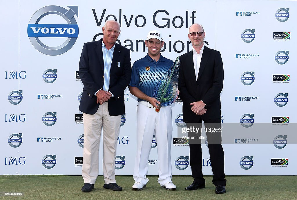 Bram van der Reep, Managing Director Volvo Car South Africa, Louis Oosthuizen of South Africa and Torbjorn Christensson, President, Volvo Group Southern Africa pose for a picture afterthe final round of the Volvo Golf Champions at Durban Country Club on January 13, 2013 in Durban, South Africa.