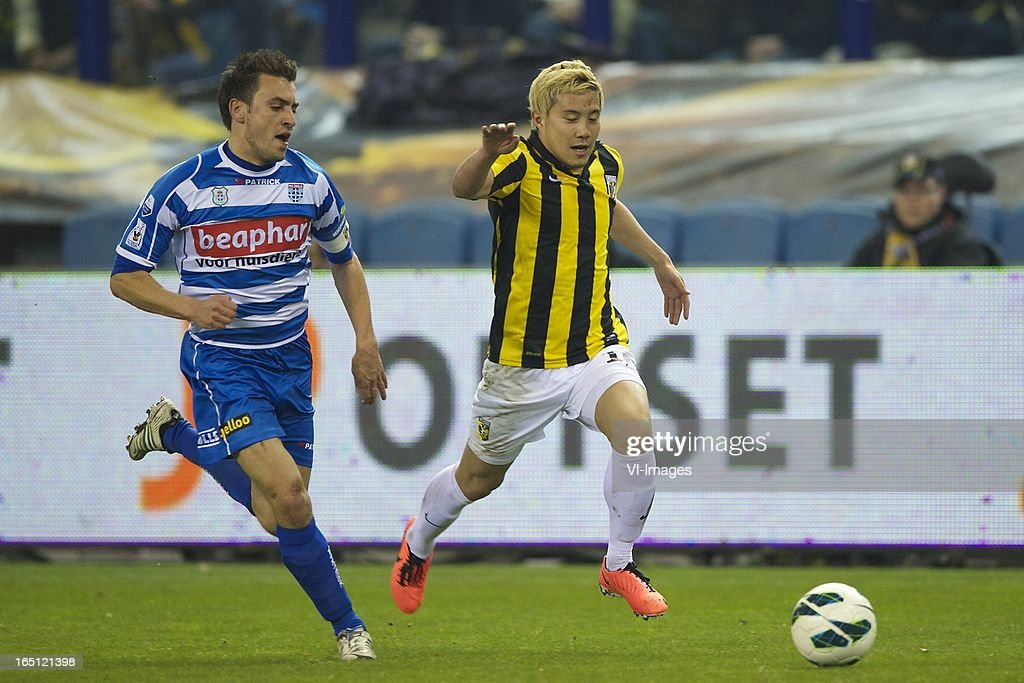 Bram van Polen of PEC Zwolle, Michihiro Yasuda of Vitesse during the Dutch Eredivisie match between Vitesse Arnhem and PEC Zwolle at the Gelredome on march 31, 2013 in Arnhem, The Netherlands