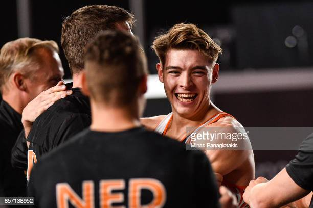 Bram Verhofstad of Netherlands celebrates with teammates after competing on the floor exercise during the qualification round of the Artistic...