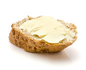 One wheat bran bread snack with butter isolated on white background