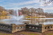 The fountain and cherry blossom trees of Branch Brook Park in Newark NJ.