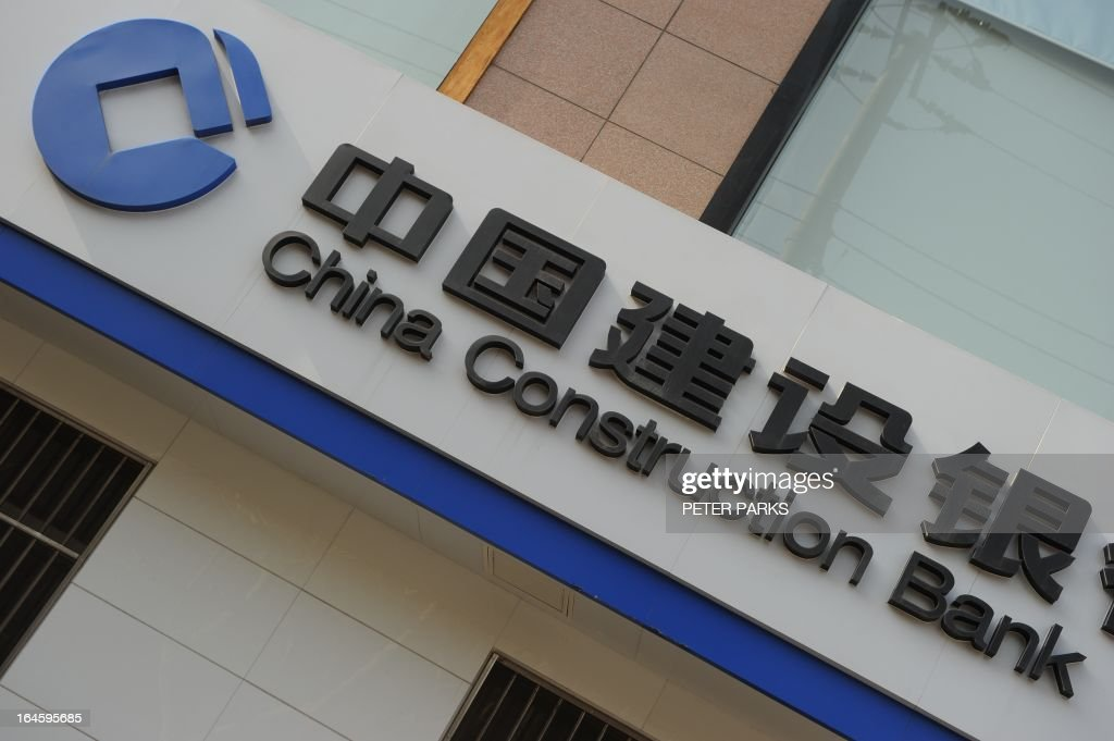 A branch of the China Construction Bank is seen in Shanghai on March 25, 2013. China Construction Bank, one of the country's top four lenders, said its net profit rose 14.1 percent year-on-year in 2012, lifted by growth in net interest income. AFP PHOTO / Peter PARKS