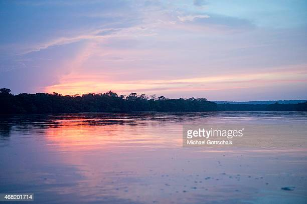 Bayanga Central African Republic March 13 Branch of the SanghaRiver in the dusk on March 13 2015 in Bayanga Central African Republic