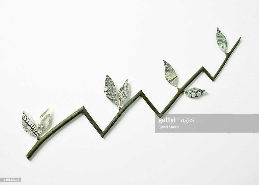 Branch with money leaves resembling a graph : Stock-Foto