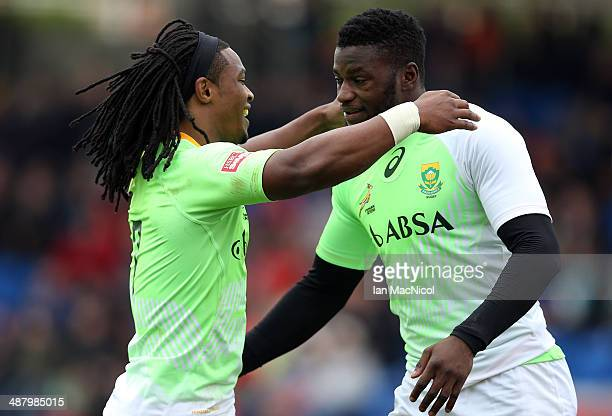Branco du Preez of South Africa celebrates with Jamba Ulengo of South Africa after his try during the game against Samoa during the IRB Glasgow...