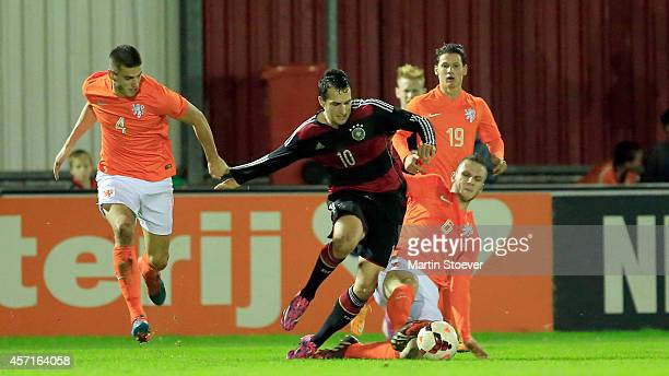 Branco van den Boomen of U20 Netherlands challenges Levin Oeztunali of U20 Germany during the match between U20 Netherlands v U20 Germany at...