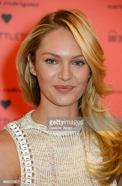 Brand ambassador Candice Swanepoel poses at a photocall to launch the 'Narcisco Rodriguez Bottletop' collection at Harrods on February 14 2014 in...